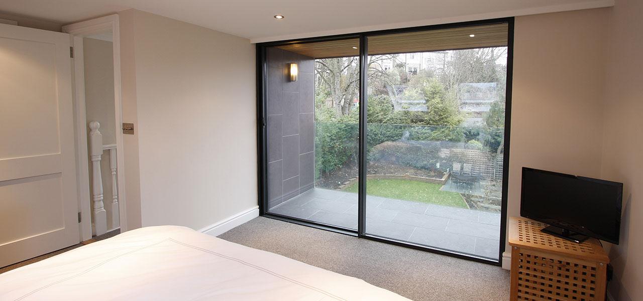 Juliet balconies minimal windows by iq glass for Balcony sliding door