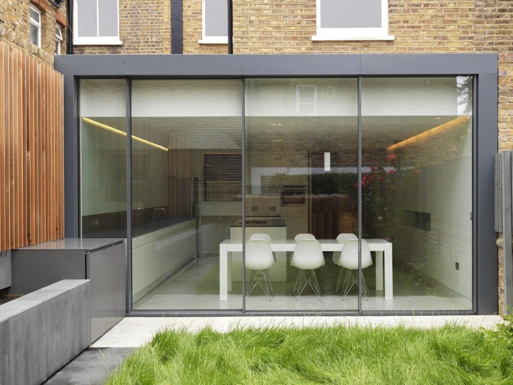 Minimal windows in house extensions slim frame sliding for Sliding glass doors extension