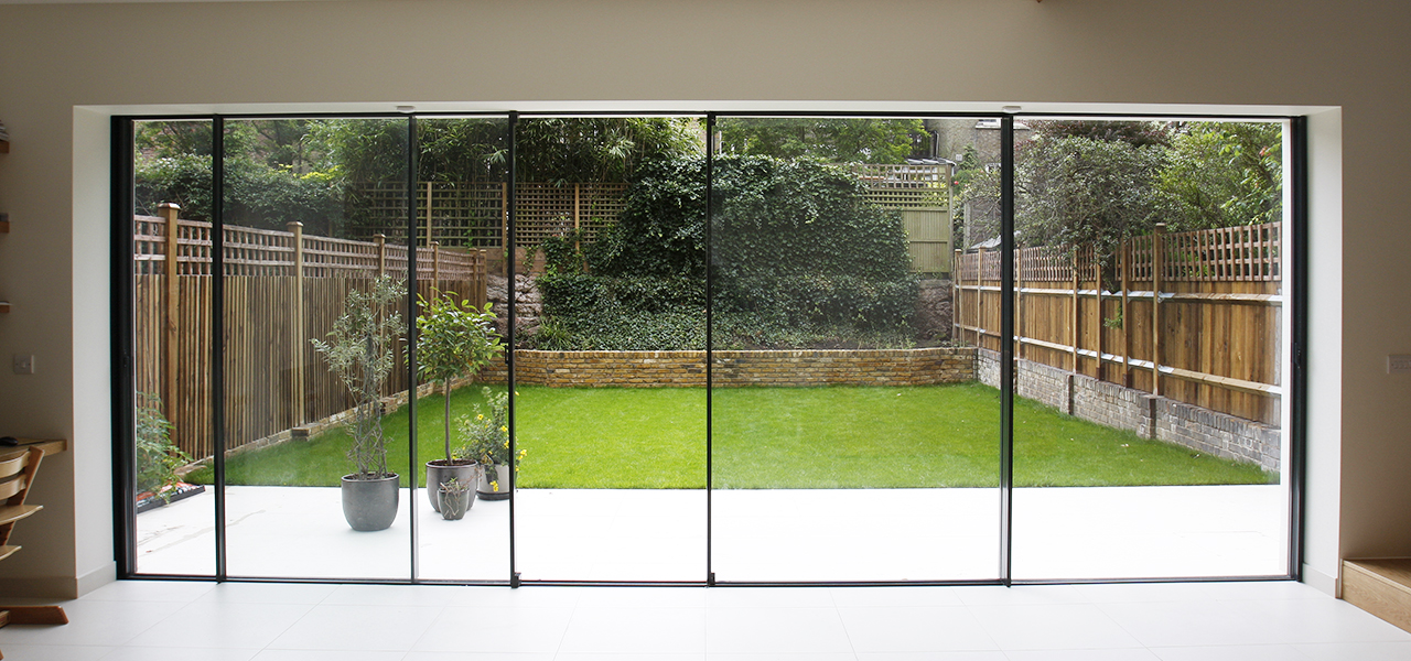 Modern patio doors bi fold doors vs sliding doors slim for Large folding patio doors