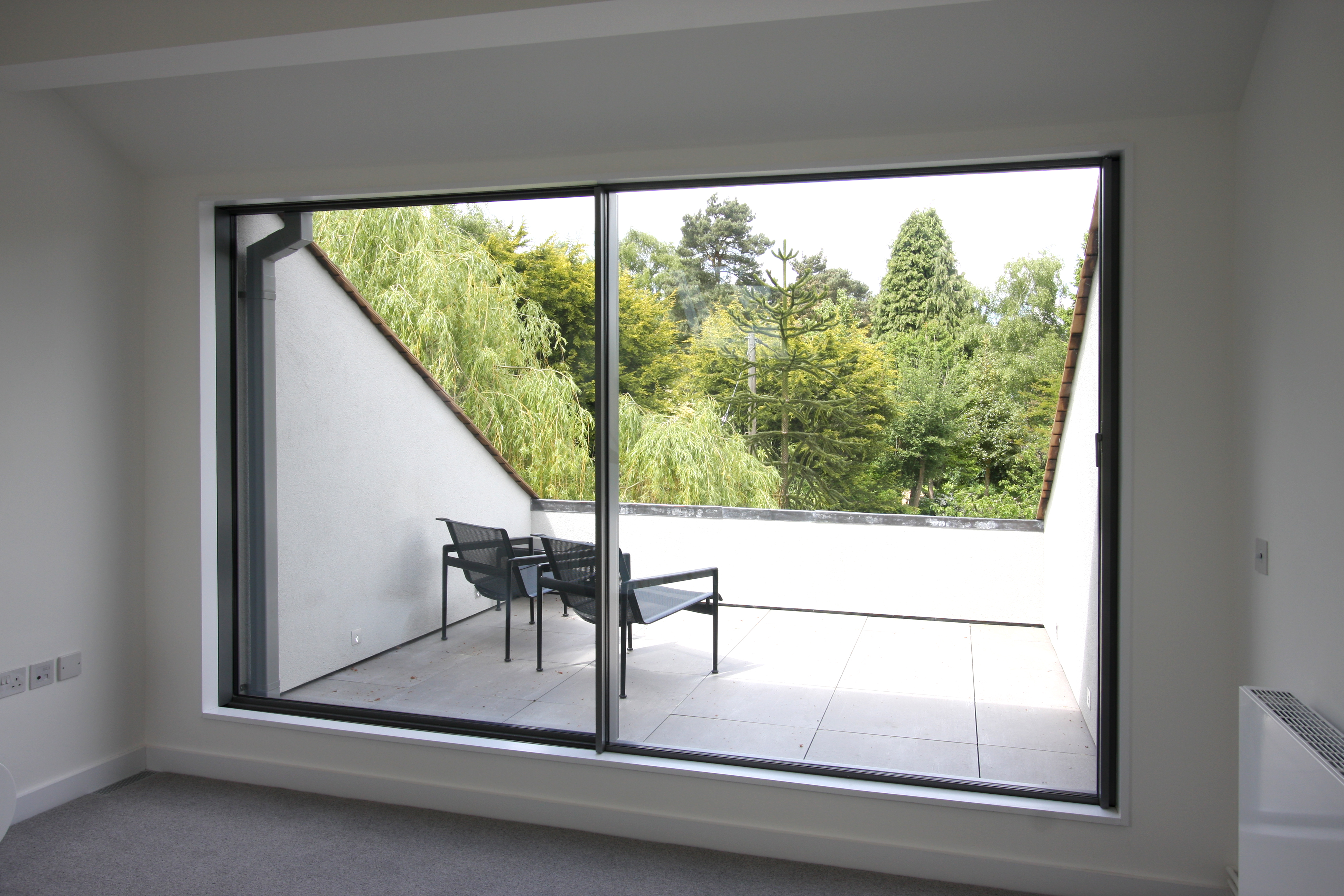 minimal windows leading out onto the first floor bedroom balcony