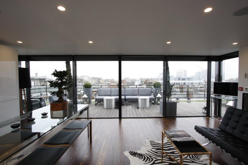 Minimal Windows leading onto a rooftop terrace