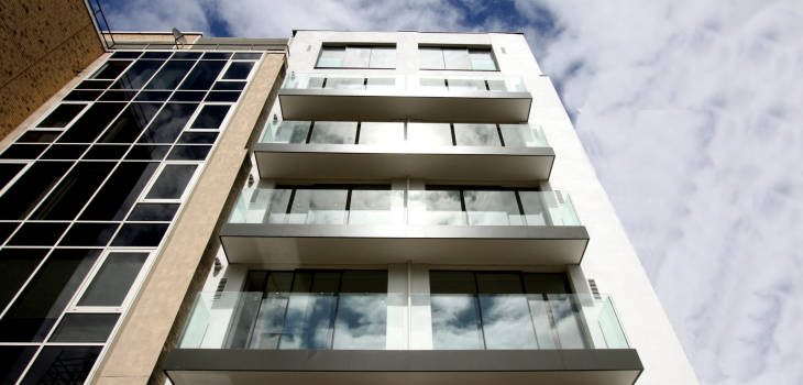 slim frame sliding glass door facade