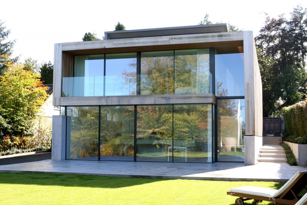 New Build House Uses Floor To Ceiling Sliding Glass Doors