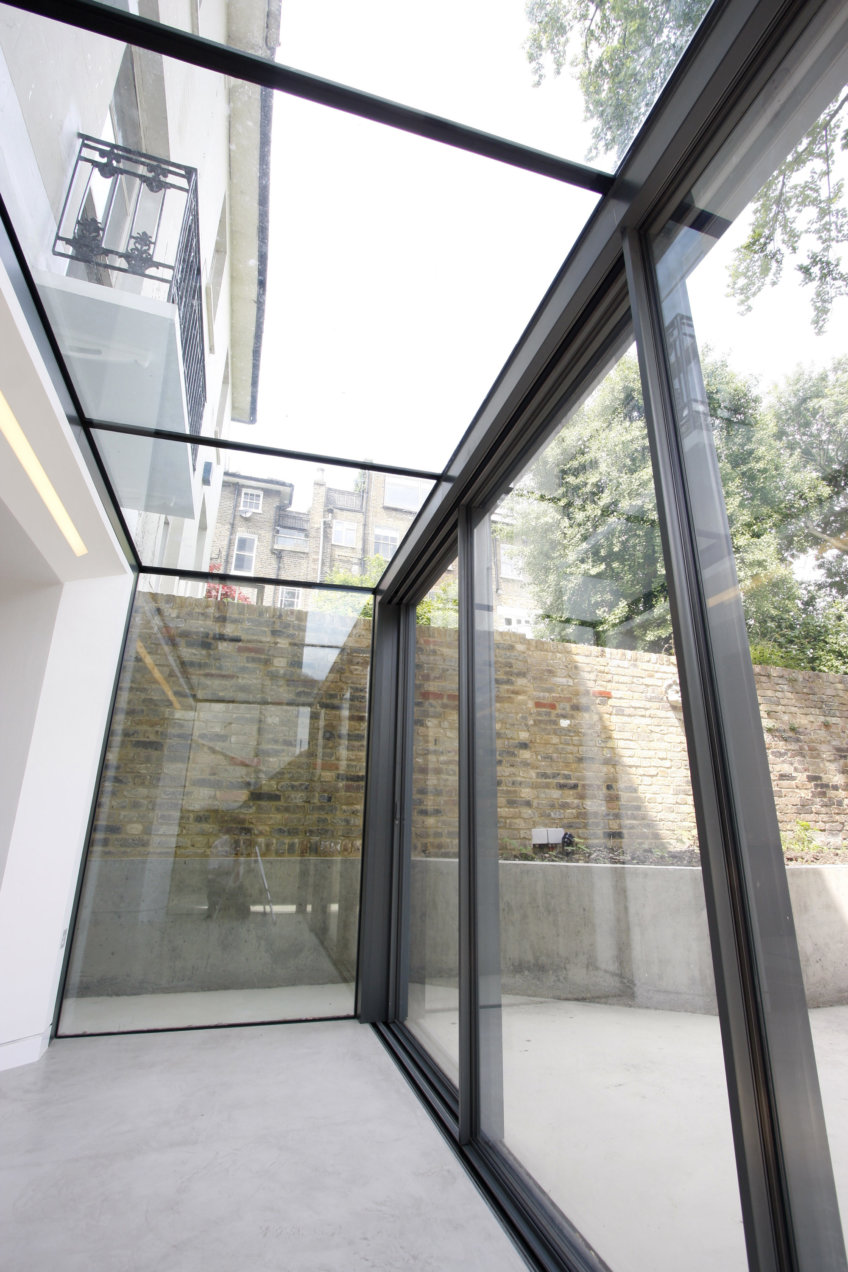 Slim frame sliding glass doors joint structural roof glazing and walls