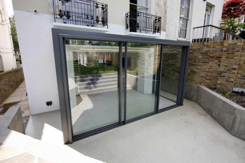 Slim frame sliding glass doors provide uninterrupted views of the carefully landscaped garden