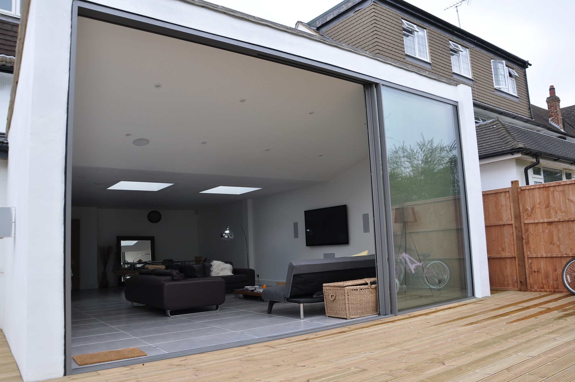 KELLER minimal windows® Slim frame sliding glass doors to a contemporary extension in Hertfordshire