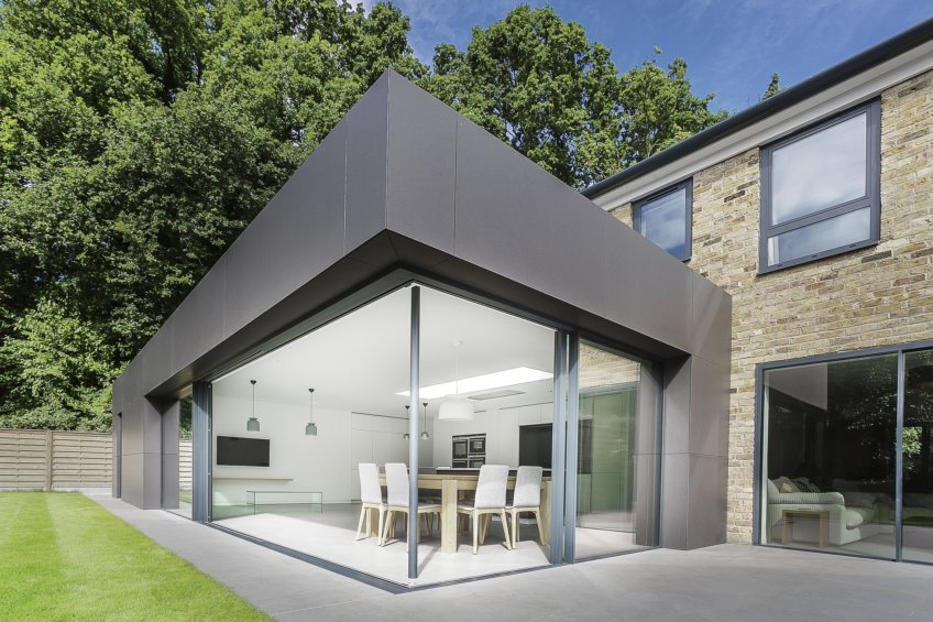 When the minimally framed doors are parted it created an open corner form a 'floating roof'