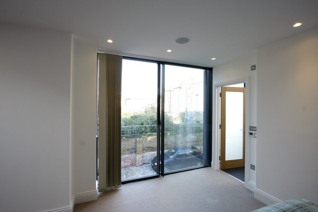 Minimally framed sliding doors were used to both the lower and upper floors providing light-filled interiors