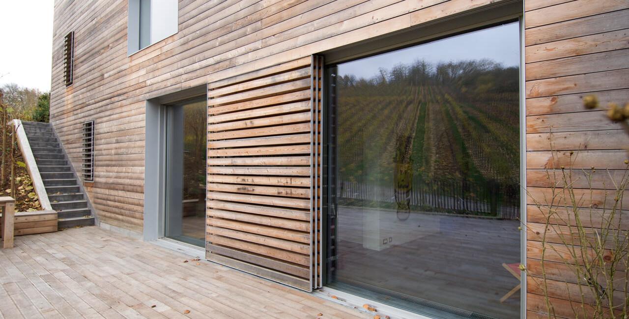 timber clad hidden pocket sliding doors