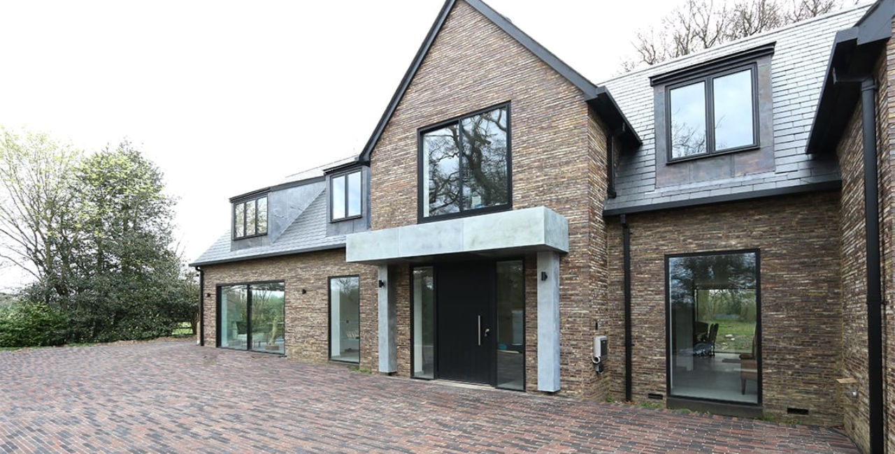 slim sightline sliding glass doors used on house in the wood project