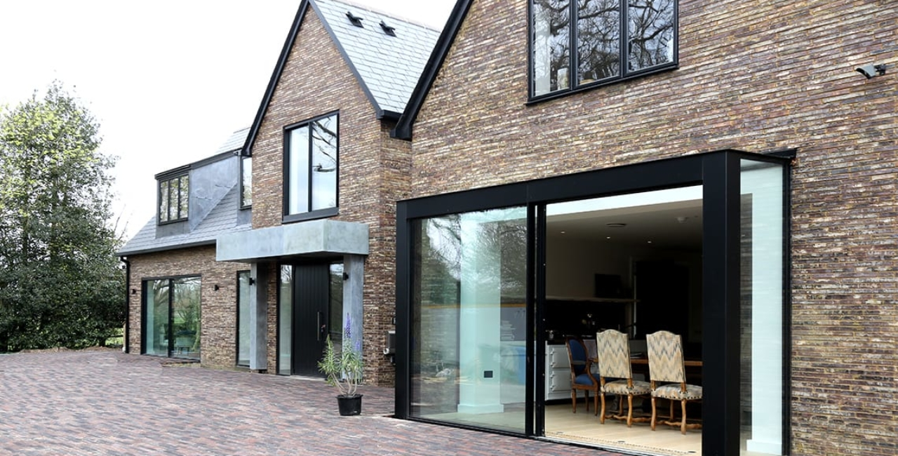 the house in the wood slim frame sliding glass doors