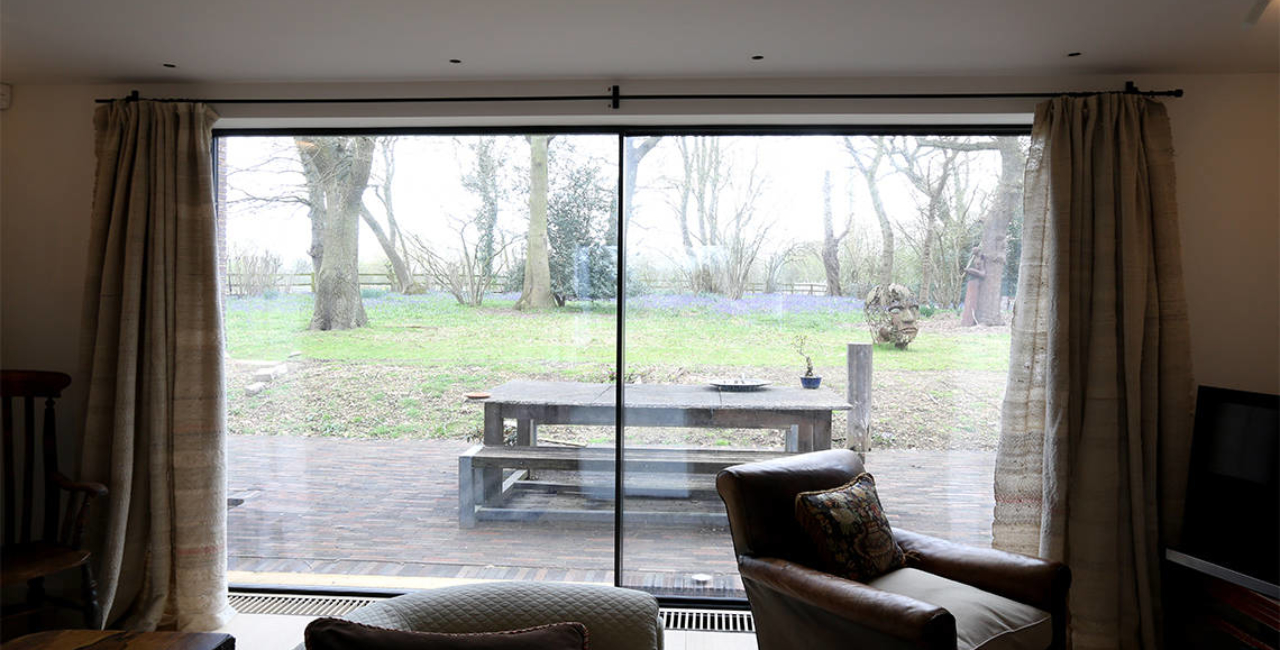 the house in the wood project using slim frame sliding glass doors