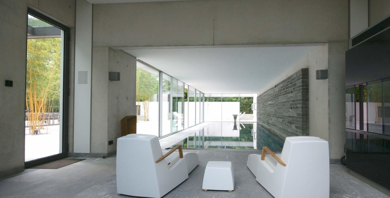 Large Glass Sliding Doors Used With Indoor Pool House
