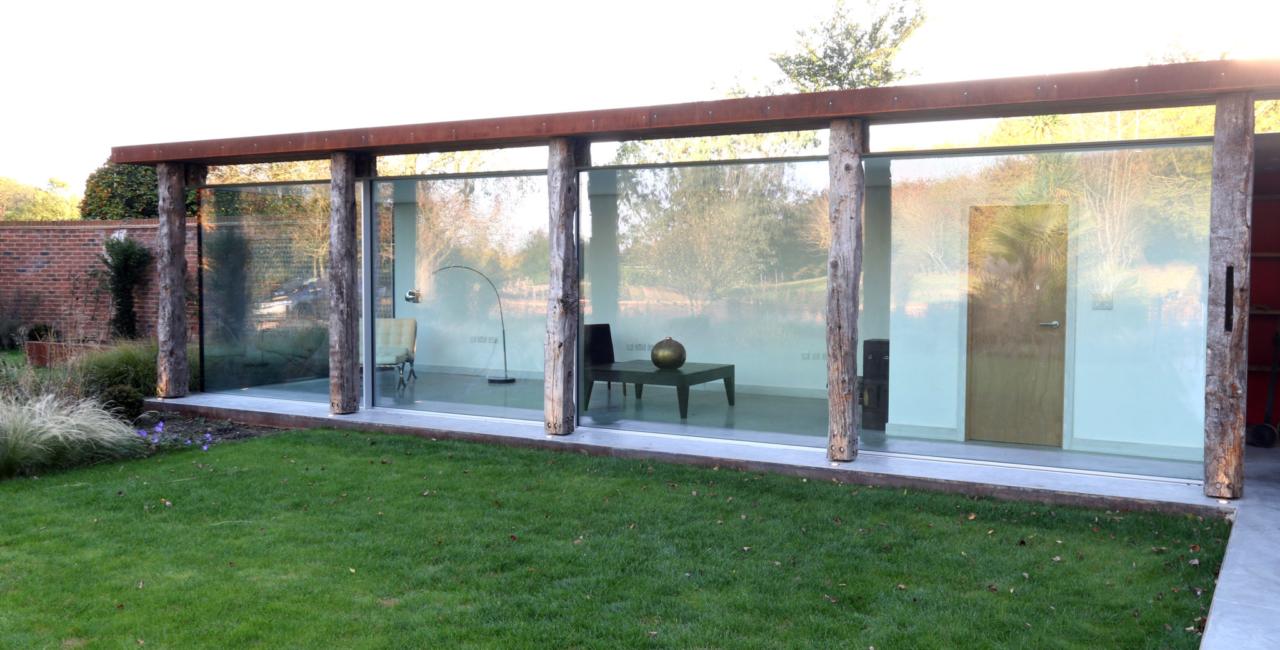 minimally framed sliding glass doors on a barn conversion