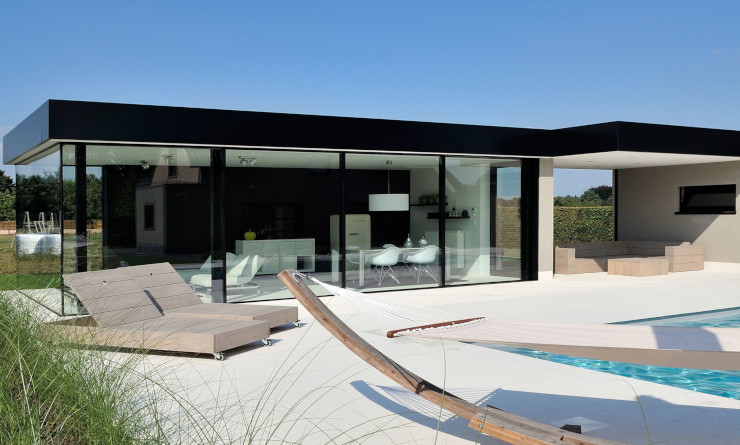 Black and White Pool House with minimal windows