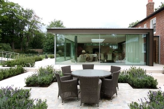 oversized sliding glass doors on a contemporary glass extension