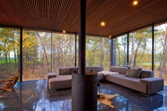 sustainable home surrounded by woodlands with floor to ceiling corner opening slim sliding glass doors