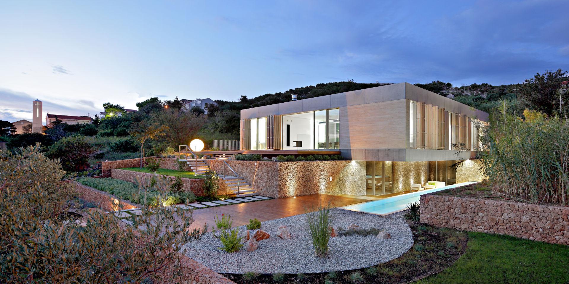 luxury villa with slim framed sliding glass doors