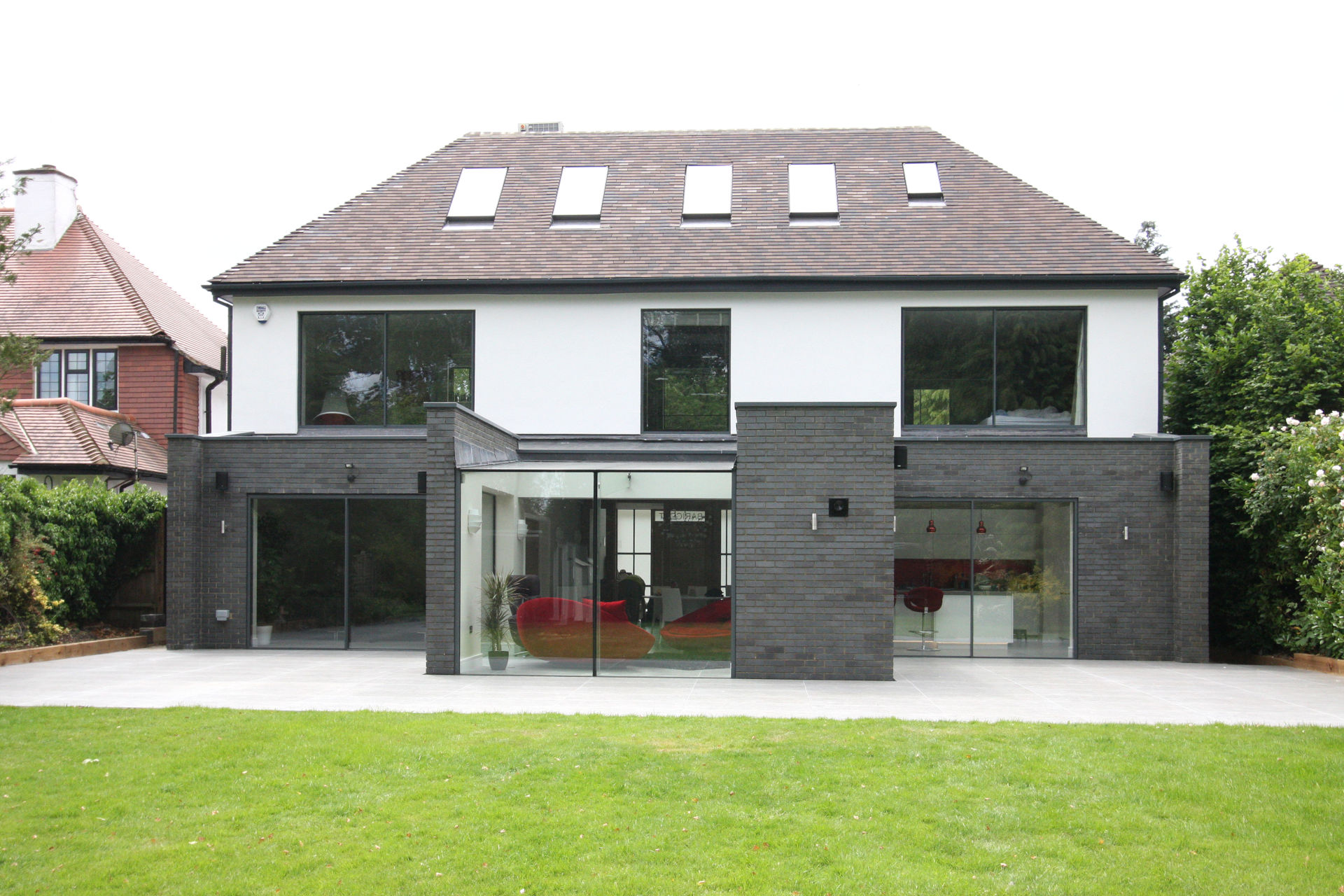 sliding glass doors to contemporary house extension