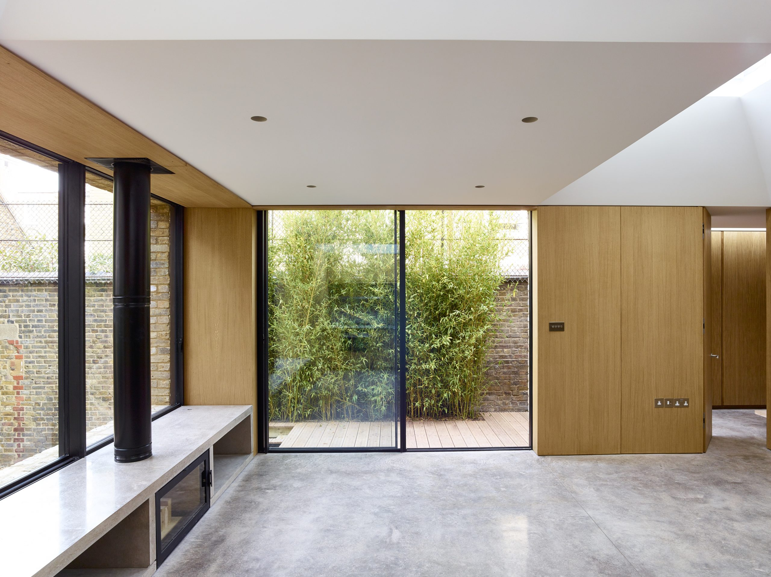 Open plan contemporary living space with Minimal windows sliding doors