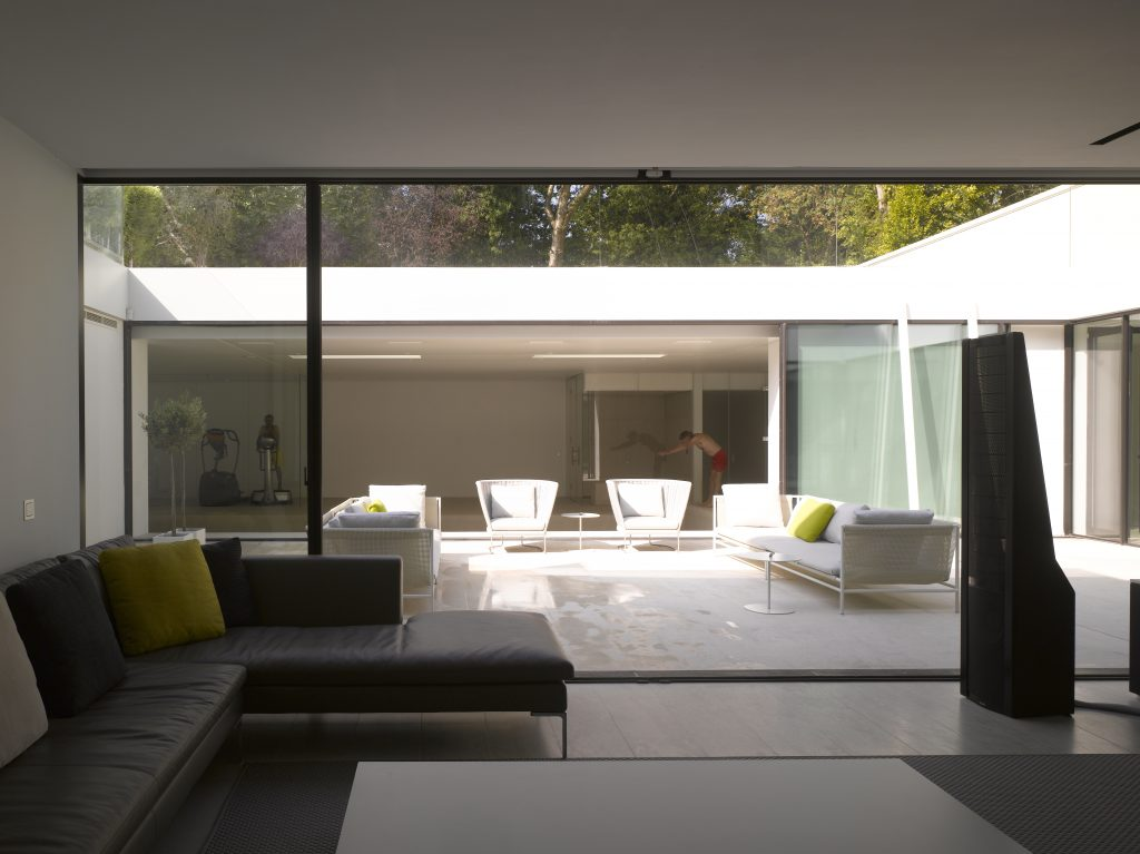 Contemporary glass box extension with minimal windows sliding doors