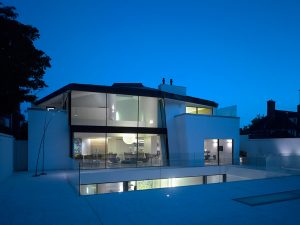 Contemporary new build two storey glass box extension