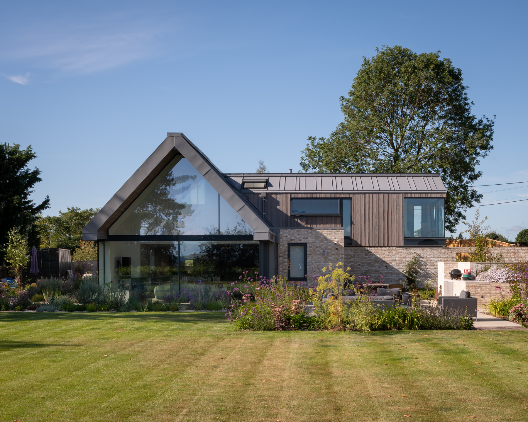 Contemporary new build home with aluminium structural glazed facade