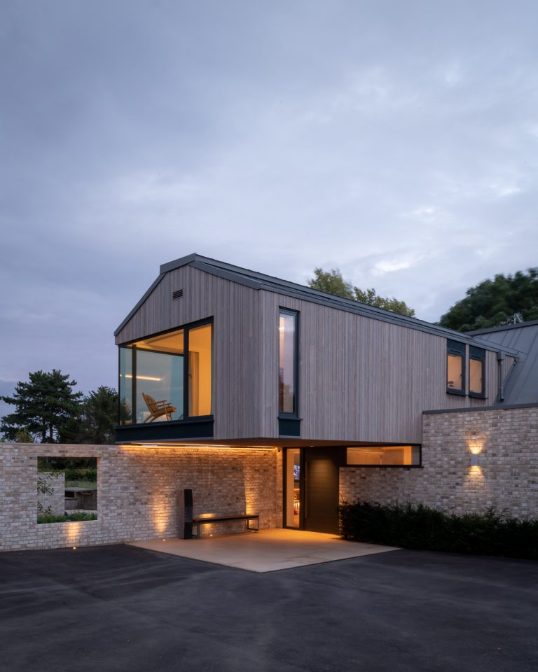 Timber clad extension with structural glass wall and aluminium windows