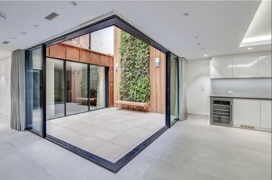 corner opening slim sliding doors to an internal courtyard