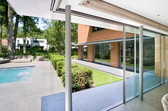 corner opening slim sliding doors with a flush threshold and concealed head frame