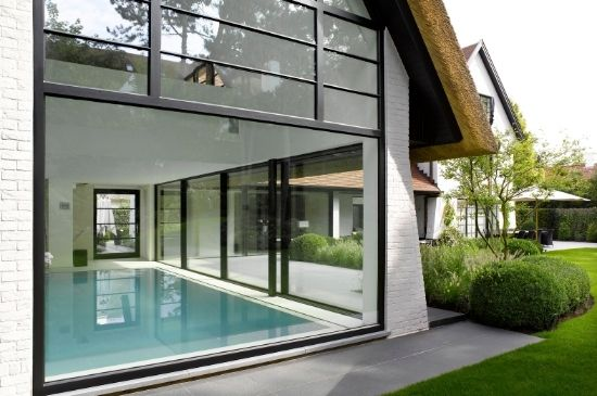double height window with large bottom fixed pane and steel look glazing on the upper section