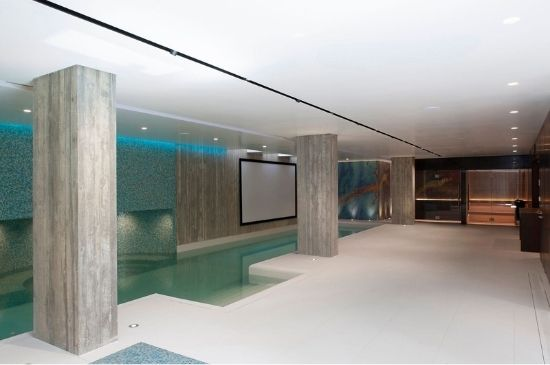 indoor basement swimming pool in a luxury residential home