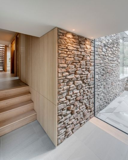 natural wood and stone building materials in a luxury new build home