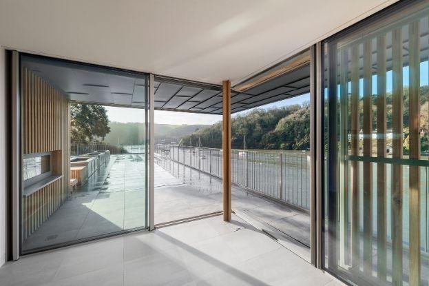 new build home with corner opening slim sliding door