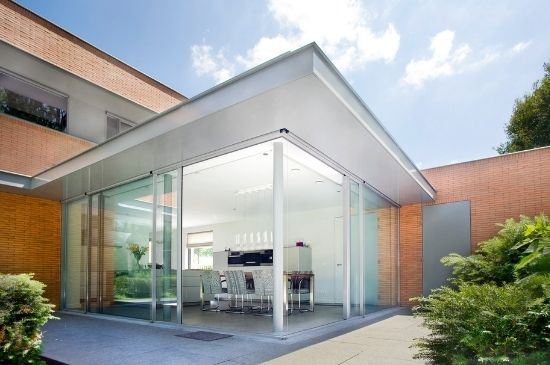 single storey extension dining area with corner opening sliding glass doors