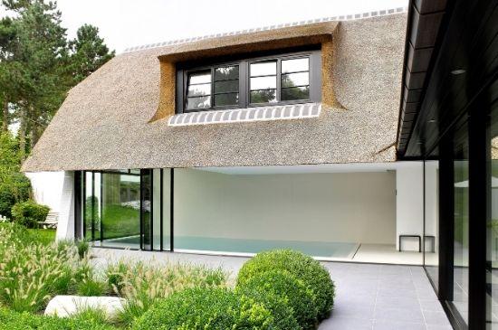 slim sliding minimal windows door on thatched roof pool house below steel look windows
