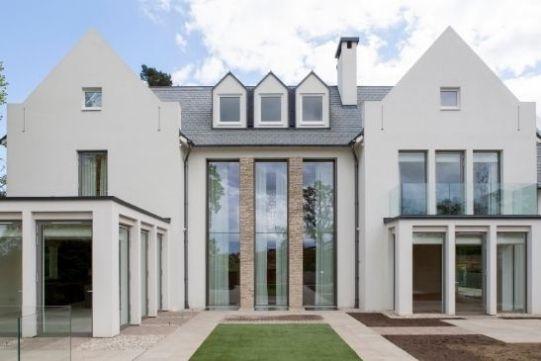 three automated vertical sliding sash windows - double height glazing