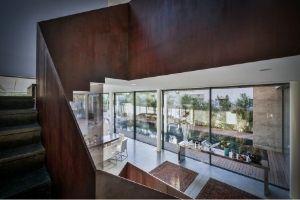dark wood interior design elements and minimal windows slim sliders