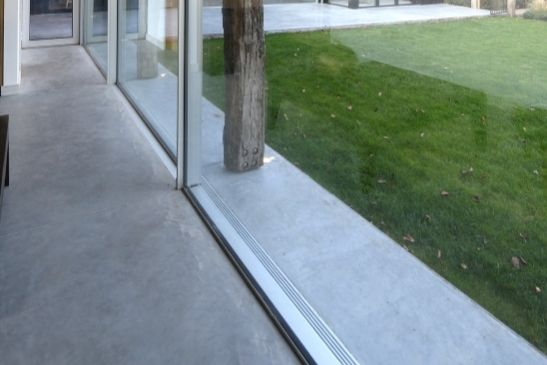 external drainage system used in conjunction with a minimal windows sliding glass door system