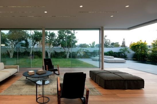 floor to ceiling glazing in the form of corner opening slim sliders in a luxury residential home