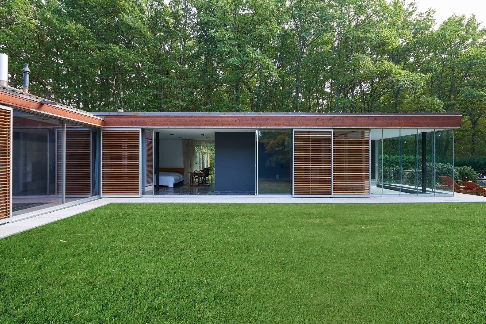 floor to ceiling ultra slim sliding glass doors with external wooden shutters