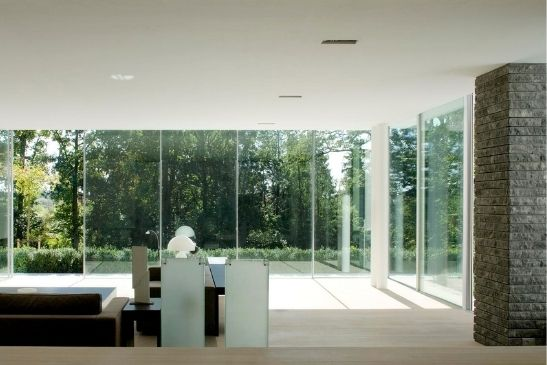internal views of the glass walls made from floor to ceiling glazing and oversized sliding glass doors