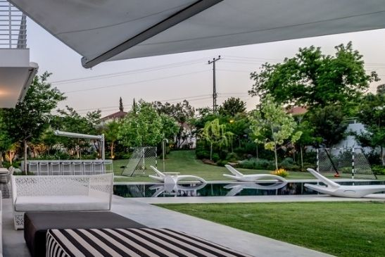 luxury garden area with football goals on a high end holiday property with slim sliders