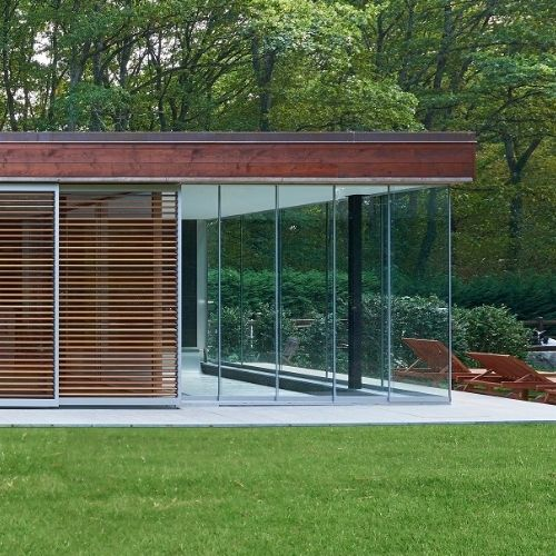 minimally framed sliding glass doors with panoramic uninterrupted views and silver aluminium frames