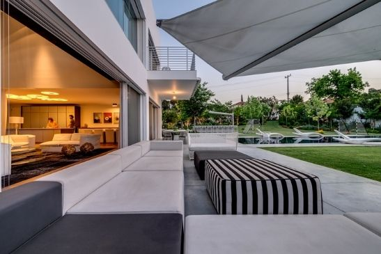 oversized slim sliding glass doors leading to an outdoor seating area