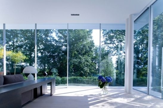 tall minimally framed glass walls with slim sliders and sliding glass panes