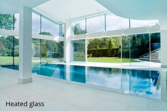 Heated sliding glass doors used around and indoor swimming pool area to prevent condensation build up
