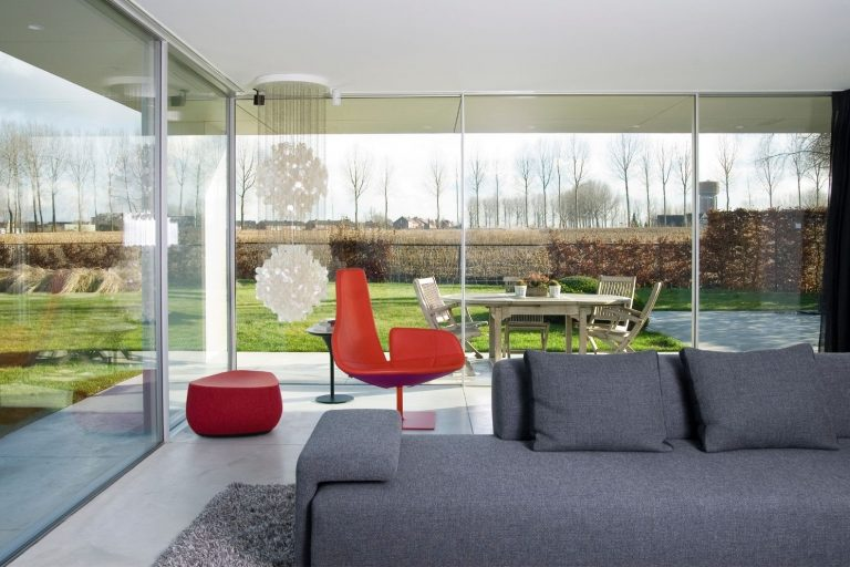 minimal windows floor to ceiling sliding glass doors is a corner configuration
