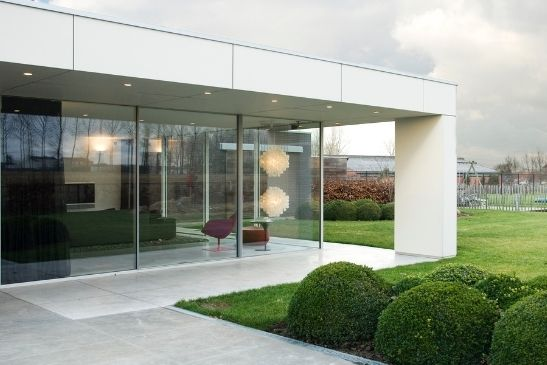 contemporary home extension with sliding glass walls made from large sliding glass doors from minimal windows
