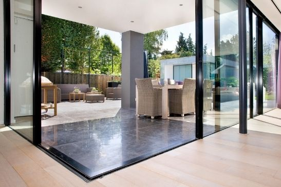 corner opening sliding glass doors with a flush threshold to create an indoor-outdoor living areas